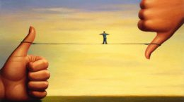 Tightrope Between Thumbs --- Image by © Images.com/Corbis
